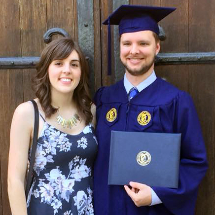 Daniel with college diploma